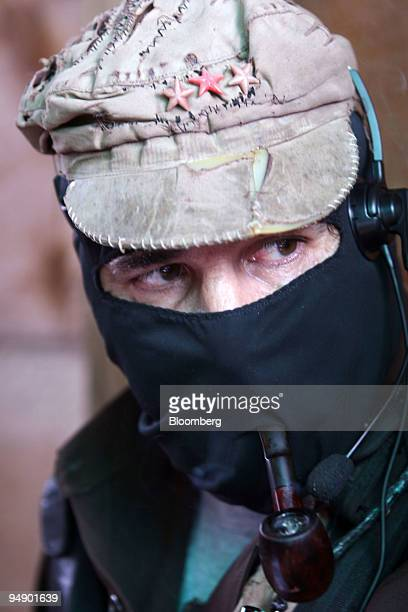 Zapatista rebel leader Subcomandante Marcos smokes a pipe during a meeting with members of the Dolores Hidalgo commune in the State of Chiapas in...