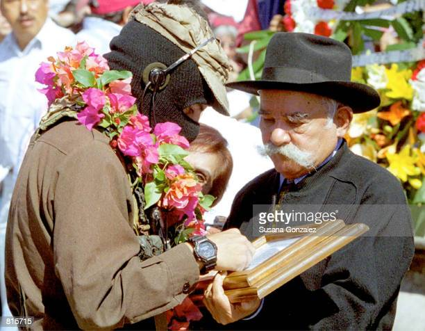 Zapatista rebel leader Subcommander Marcos left receives a gift from Mateo Zapata March 6 2001 in Anenecuilco in Mexico's Morales state Zapata is the...