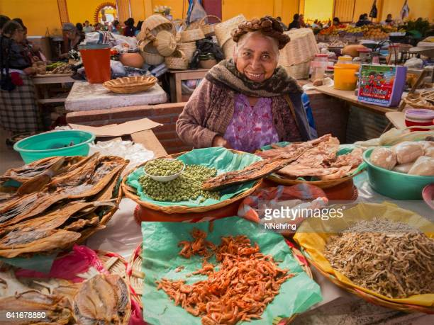 zapotec woman selling dried seafood in market - oaxaca stock pictures, royalty-free photos & images