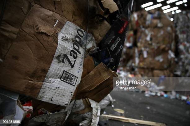 Zappos box is seen in a bundle of recycled cardboard at Recology's Recylce Central on January 4 2018 in San Francisco California Recycle centers are...