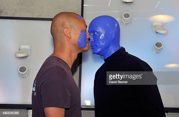 Zapposcom CEO Tony Hsieh and a member of Blue Man Group appear during the unveiling of the 'ShoeZaphone' at Zappos headquaters on May 14 2014 in Las...