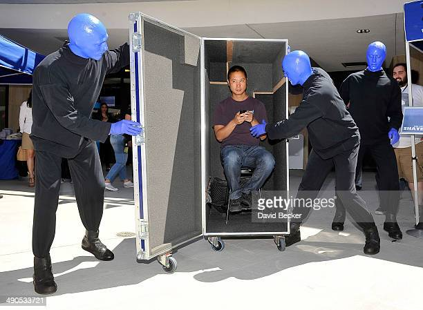 """Zappos.com CEO Tony Hsieh and members of Blue Man Group arrive at the Zappos' annual Bald and Blue fundraiser for the unveiling of the """"ShoeZaphone""""..."""