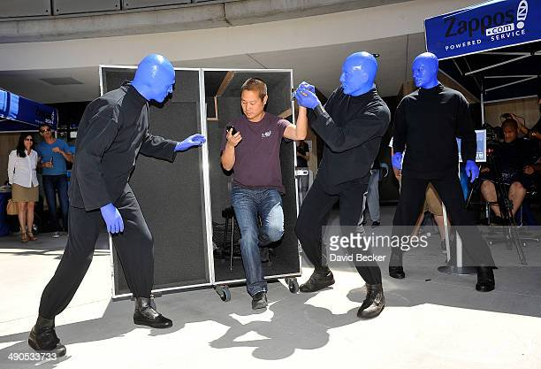 Zapposcom CEO Tony Hsieh and members of Blue Man Group arrive at the Zappos' annual Bald and Blue fundraiser for the unveiling of the 'ShoeZaphone'...