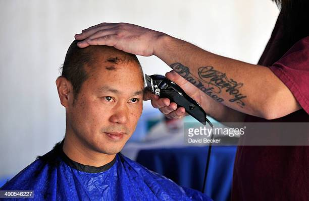 """Zappos.com CEO Tony Hsieh has his head shaved before the unveiling of the """"ShoeZaphone"""" during the annual Bald and Blue fundraiser at Zappos..."""