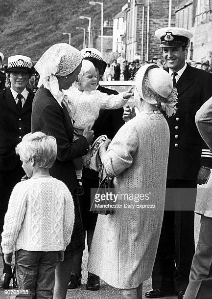 Zara held by her mother Princess Anne makes a grab for her greatgrandmother�s hat