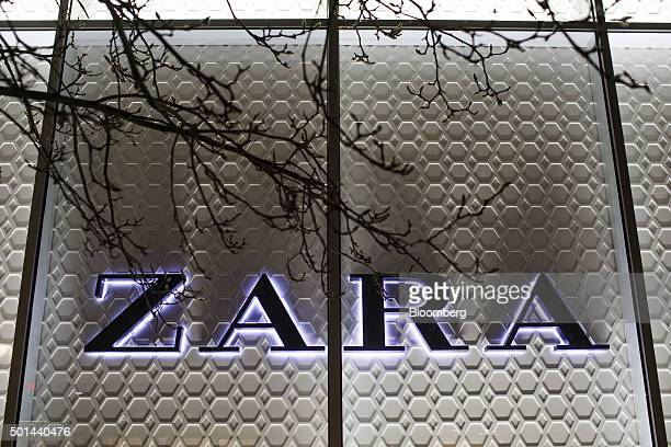 A Zara logo sits illuminated at night outside a fashion store operated by Inditex SA in San Sebastian Spain on Monday Dec 14 2015 Spain is facing a...