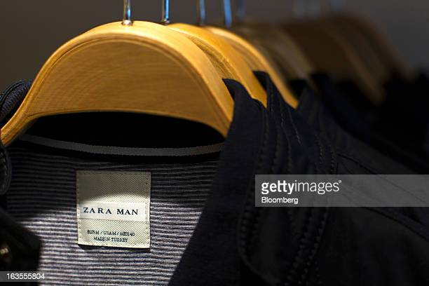 A Zara Man logo is displayed on a clothing label inside a Zara fashion store operated by Inditex SA in Madrid Spain on Tuesday March 12 2013 Europe's...