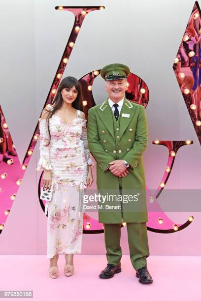 Zara Martin poses with the Harrods Green Man at the Summer Party at the VA in partnership with Harrods at the Victoria and Albert Museum on June 20...