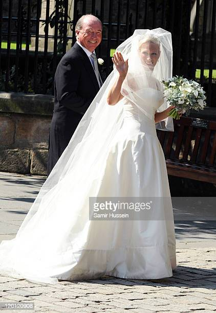 Zara Phillips accompanied by her father Captain Mark Phillips arrives at the church to marry England rugby captain Mark Phillips at Canongate Kirk on...