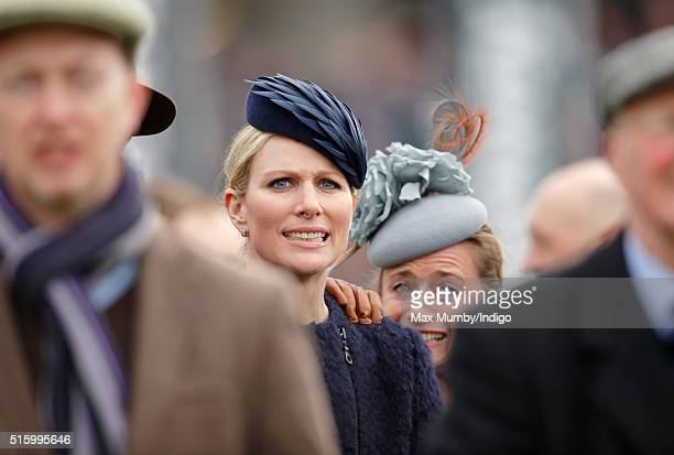 Zara Phillips and Dolly Maude watch the Queen Mother Champion Chase as they attend day 2 Ladies Day of the Cheltenham Festival on March 16 2016 in...