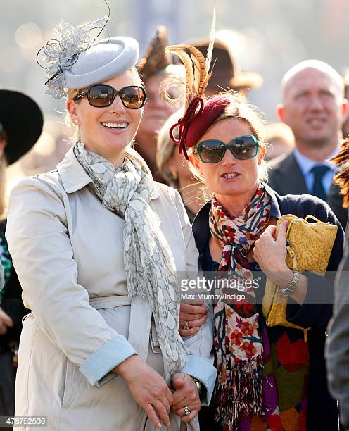 Zara Phillips and Dolly Maude watch the racing as they attend Day 4 of the Cheltenham Festival at Cheltenham Racecourse on March 14 2014 in...