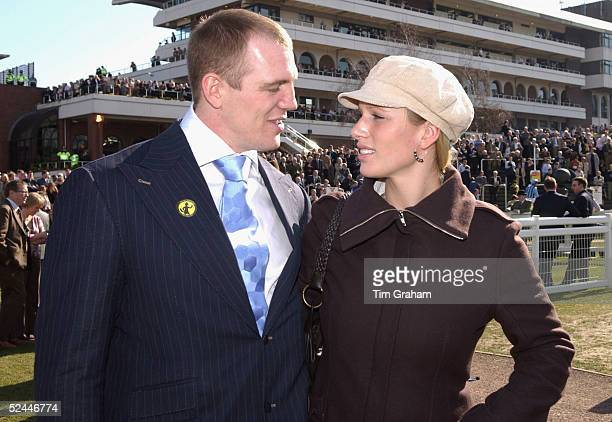 Zara Phillips and her boyfriend England rugby player Mike Tindall gaze at each other while attending the fourth day of the Cheltenham Festival at...
