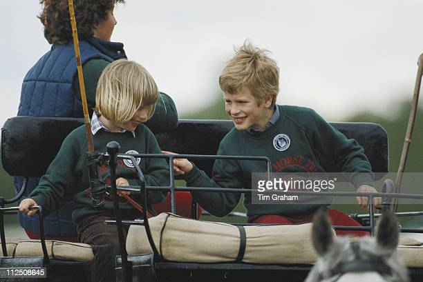 Zara Phillips and her brother Peter Phillips riding a carriage at the Royal Windsor Horse Show, held at Home Park in Windsor, Berkshire, England,...