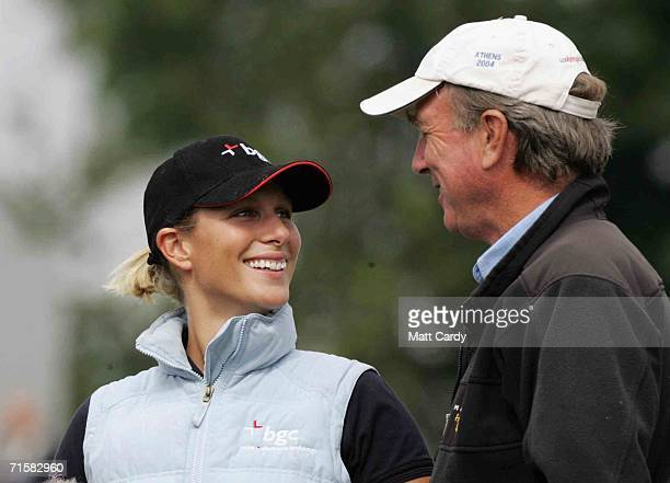 Zara Phillips and her father Captain Mark Phillips laugh together on the first day of the Gatcombe Horse Trials on the Gatcombe Estate on August 4...