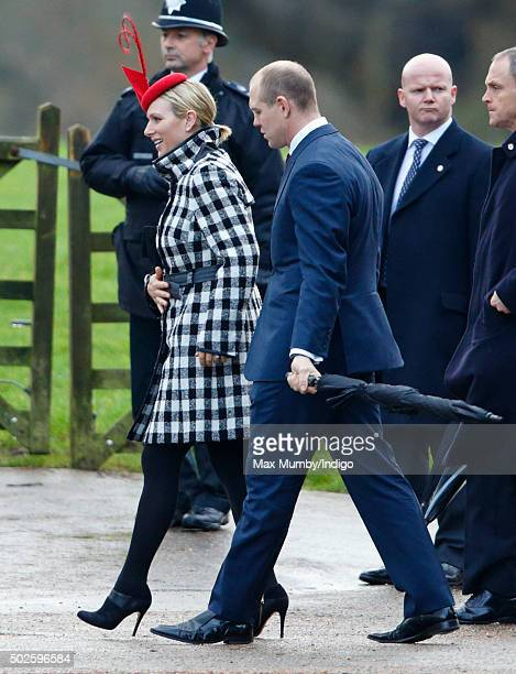 Zara Phillips and Mike Tindall depart after attending the Sunday service at St Mary Magdalene Church Sandringham on December 27 2015 in King's Lynn...