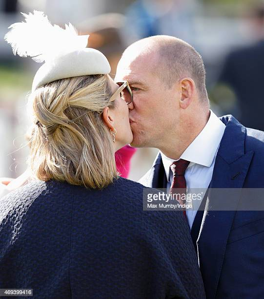 Zara Phillips and Mike Tindall kiss as they attend day 3 'Grand National Day' of the Crabbie's Grand National Festival at Aintree Racecourse on April...
