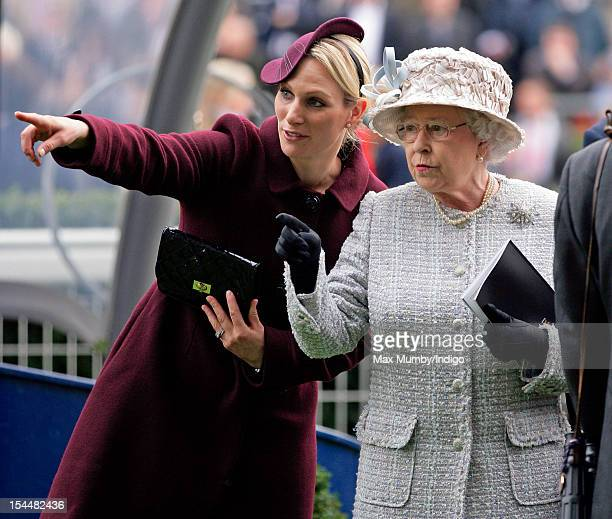 Zara Phillips and Queen Elizabeth II attend the QIPCO British Champions Day meet at Ascot Racecourse on October 20 2012 in Ascot England