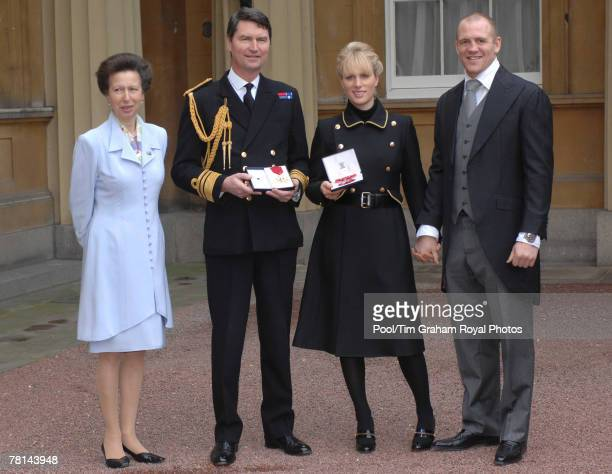 Zara Phillips awarded an MBE for services to Equestrianism and Vice Admiral Timothy Laurence awarded a CBE are accompanied by Zara's boyfriend Mike...