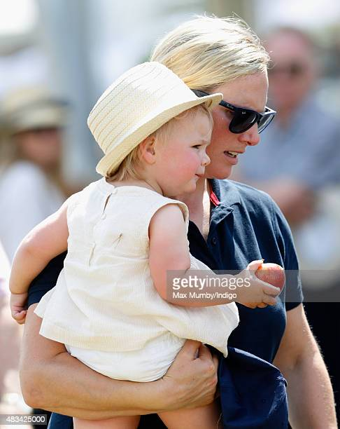 Zara Phillips carries daughter Mia Tindall as she attends day 2 of the Festival of British Eventing at Gatcombe Park on August 8 2015 in Stroud...