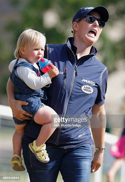Zara Phillips carries daughter Mia Tindall as they attend day 1 of the Festival of British Eventing at Gatcombe Park on August 7, 2015 in Stroud,...