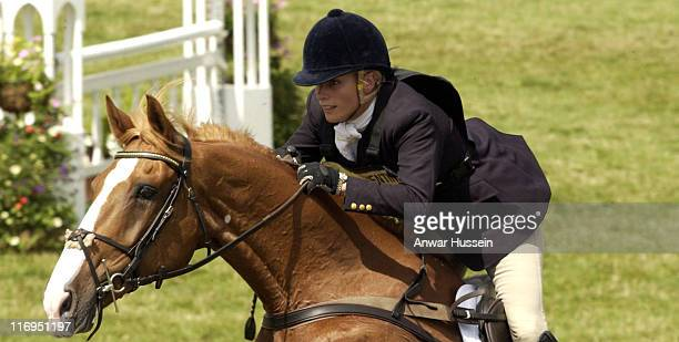 Zara Phillips, daughter of Princess Anne, competes in the showjumping section on the third day of the Gatcombe Park Festival of British Eventing at...