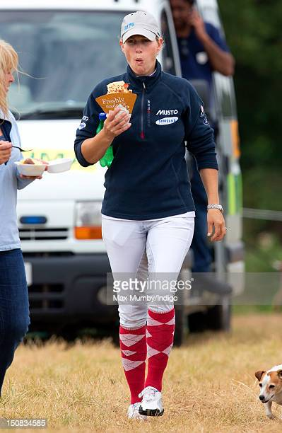 Zara Phillips eats a crepe during a break from competing in the Wellington Horse Trials on August 27 2012 in Hook Hampshire