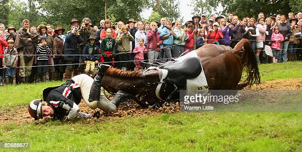 Zara Phillips falls at the 25th jump as she competes on her horse Ardfield Magic Star during cross country on day three of The Land Rover Burghley...