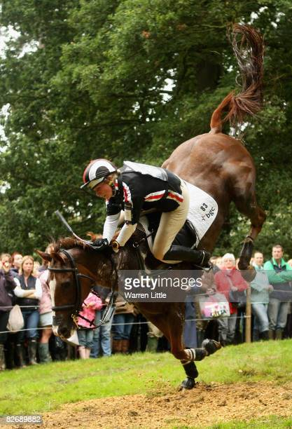 Zara Phillips falls at the 25th jump as she competes on her horse Ardfield Magic Star during the cross country event on day three of The Land Rover...