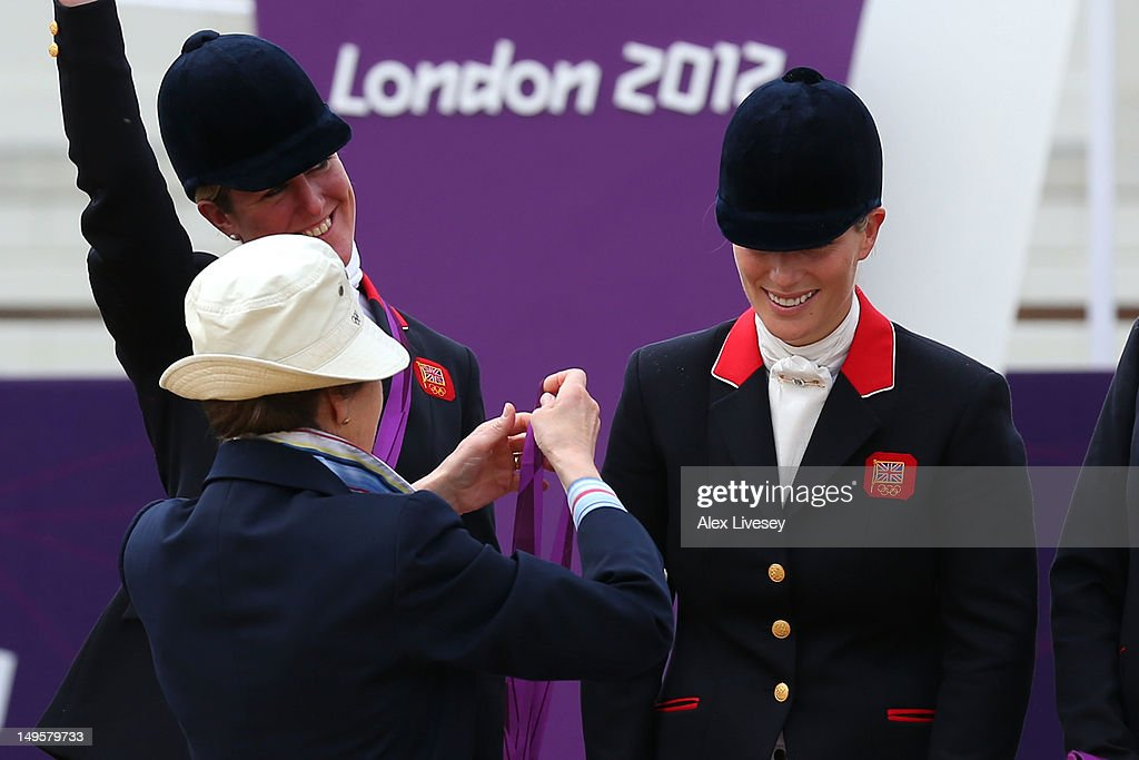 Zara Phillips is presented a silver medal by her mother, Princess Anne, Princess Royal after the Eventing Team Jumping Final Equestrian event on Day 4 of the London 2012 Olympic Games at Greenwich Park on July 31, 2012 in London, England.
