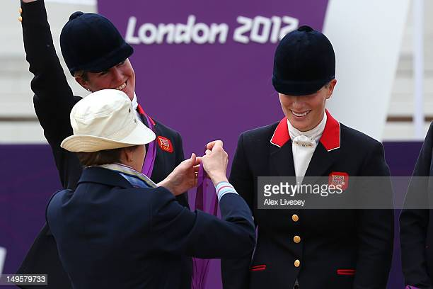 Zara Phillips is presented a silver medal by her mother, Princess Anne, Princess Royal after the Eventing Team Jumping Final Equestrian event on Day...