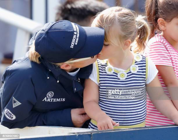 Zara Phillips kisses daughter Mia Tindall as they attend day 2 of the Festival of British Eventing at Gatcombe Park on August 5 2017 in Stroud England