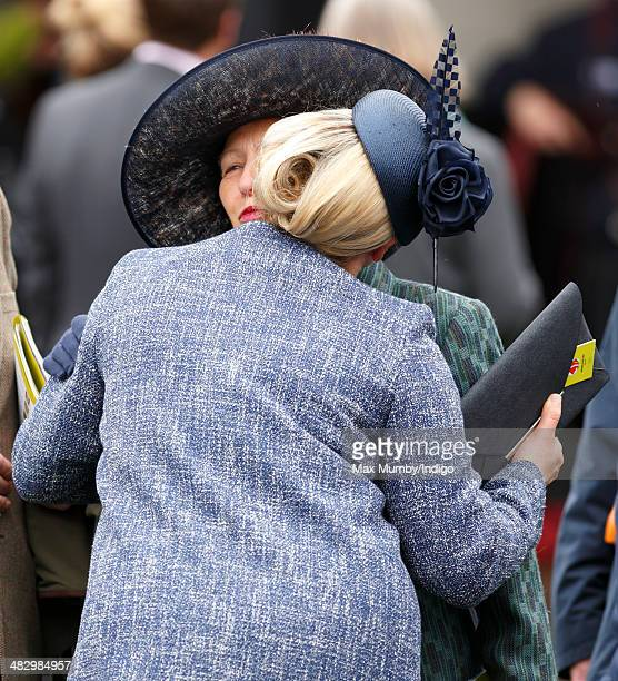 Zara Phillips kisses her mother Princess Anne The Princess Royal as they attend the Crabbie's Grand National horse racing meet at Aintree Racecourse...