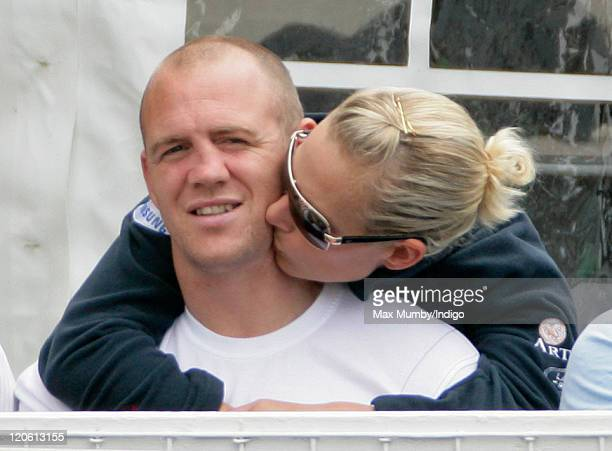 Zara Phillips kisses husband Mike Tindall as they attend day 3 of The Festival of British Eventing at Gatcombe Park on August 7, 2011 in Stroud,...