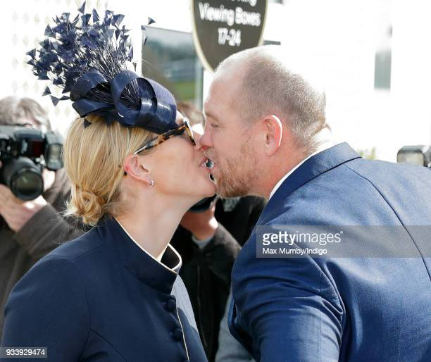 Zara Phillips kisses husband Mike Tindall as they attend day 4 'Gold Cup Day' of the Cheltenham Festival at Cheltenham Racecourse on March 16 2018 in...