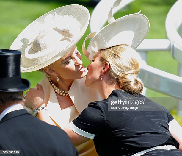 Zara Phillips kisses Princess Michael of Kent as they attend Day 1 of Royal Ascot at Ascot Racecourse on June 17 2014 in Ascot England
