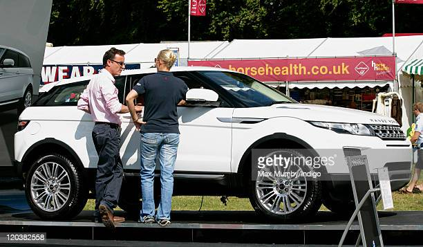 Zara Phillips looks at the new Range Rover Evoque on the Land Rover stand as she attends day 1 of The Festival of British Eventing at Gatcombe Park...