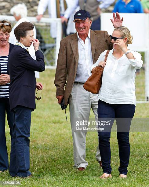 Zara Phillips looks on as her mother Princess Anne The Princess Royal and father Mark Phillips share a joke during day 1 of the Festival of British...
