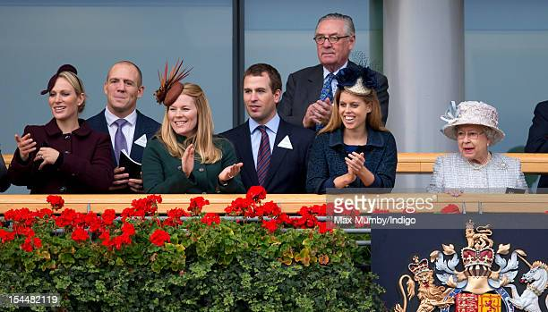 Zara Phillips, Mike Tindall, Autumn Phillips, Peter Phillips, Lord Vestey, Princess Beatrice and Queen Elizabeth II watch Frankel enter the winner's...