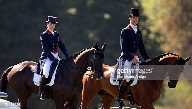 Zara Phillips on her horse 'Black Tuxedo' rides alongside William FoxPitt as she prepares to compete in the dressage phase of the Blenheim Palace...