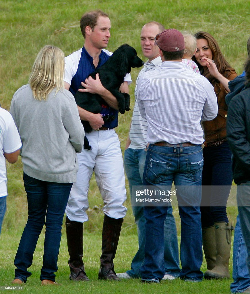 Zara Phillips, Prince William, Duke of Cambridge (carrying his dog Lupo), Mike Tindall, Peter Phillips and Catherine Duchess of Cambridge attend The Golden Metropolitan Polo Club Charity Cup polo match, in which Prince William, Duke of Cambridge and Prince Harry played, at the Beaufort Polo Club on June 17, 2012 in Tetbury, England.