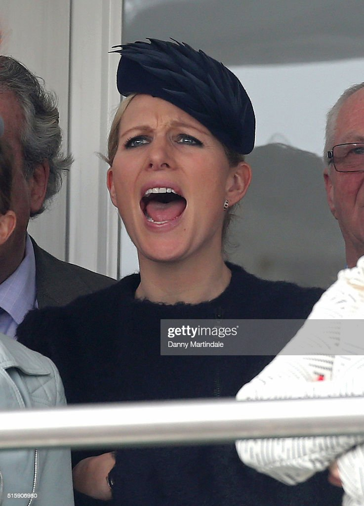 Zara Phillips pulls a face while watching the racing on Ladies Day, the second day of the Cheltenham Festival at Cheltenham Racecourse on March 16, 2016 in Cheltenham, England.
