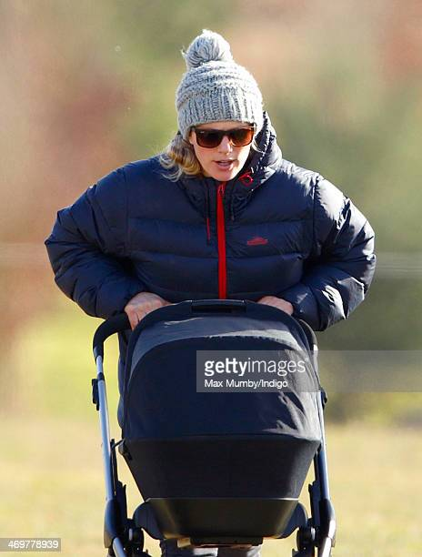 Zara Phillips pushes her baby daughter Mia Tindall in her pushchair as she attends the Barbury Castle PointtoPoint race meeting at Barbury Racecourse...
