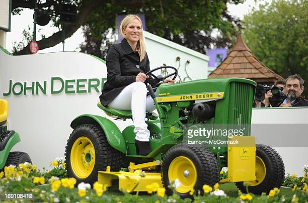 Zara Phillips sits on a tractor mower on the Joh Deere stand during the Chelsea Flower Show press and VIP preview day at Royal Hospital Chelsea on...