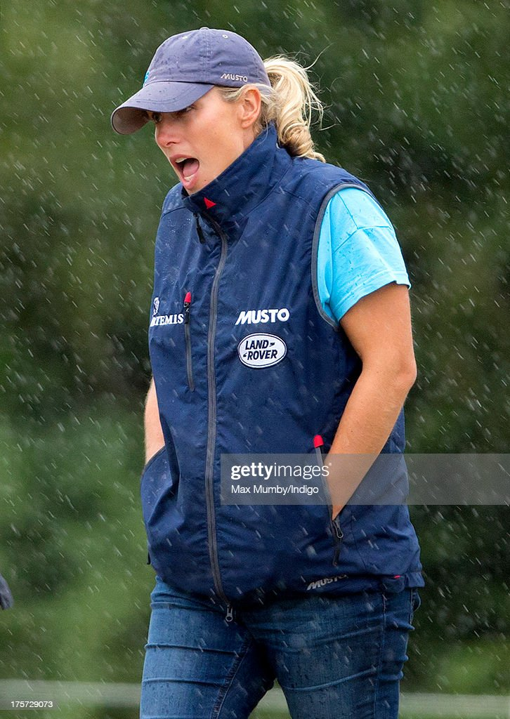 Zara Phillips stands in the rain as she watches rider Aimee Aspinall compete, on one of Zara's horses, at the Smiths Lawn Horse Trials on August 5, 2013 in Windsor, England.