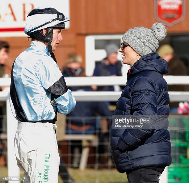 Zara Phillips talks with a jockey as she attends the Barbury Castle PointtoPoint race meeting at Barbury Racecourse on February 16 2014 in...