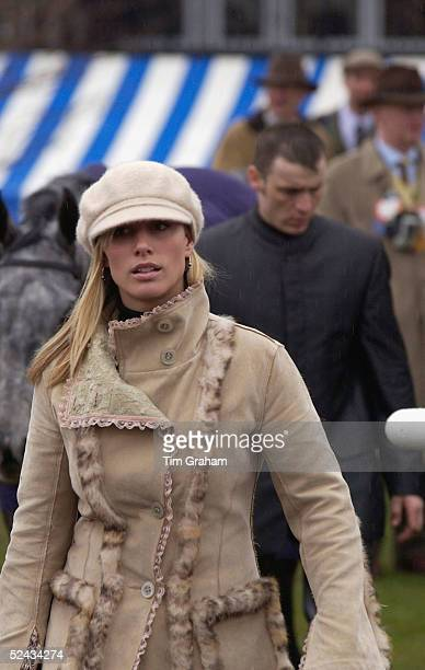 Zara Phillips, the daughter of The Princess Royal, walks in the paddock at Cheltenham Racecourse during the second day of the annual National Hunt...