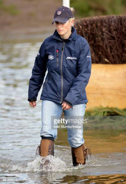 Zara Phillips wades through the water obstacle as she walks the cross country course of the Badminton Horse Trials on April 30, 2010 in Badminton,...