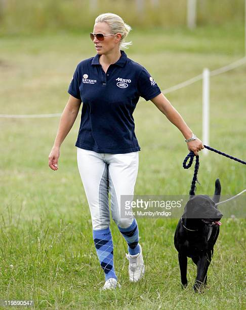 Zara Phillips walks her dog around the cross country course during a break from competing in the AstonleWalls Horse Trials on July 22 2011 in...
