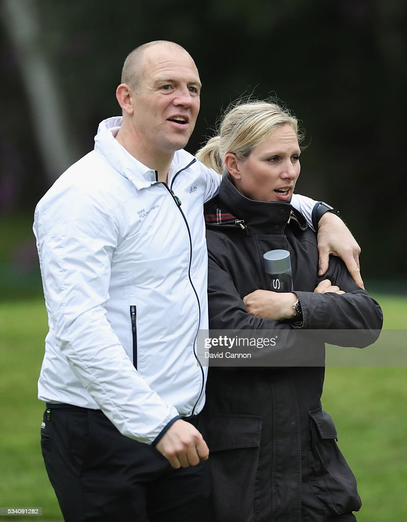 Zara Phillips (R) walks with husband Mike Tindall during the Pro-Am prior to the BMW PGA Championship at Wentworth on May 25, 2016 in Virginia Water, England.