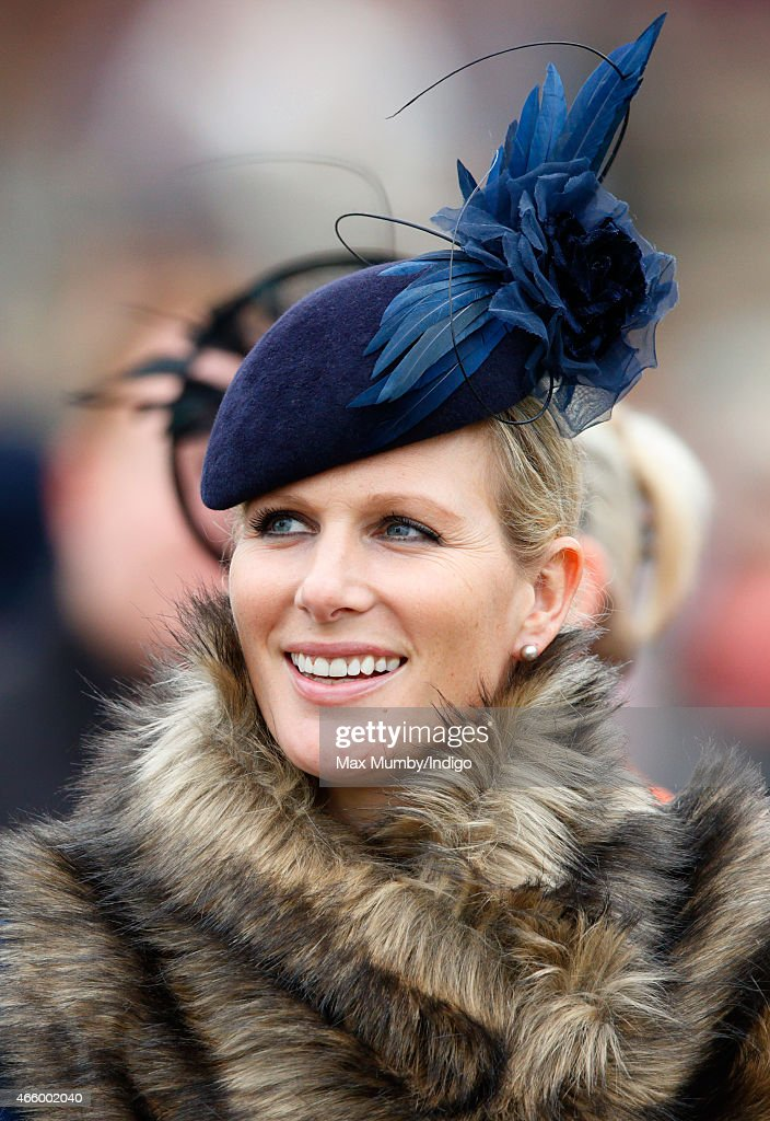 Zara Phillips watches the racing as she attends day 3 of the Cheltenham Festival at Cheltenham Racecourse on March 12, 2015 in Cheltenham, England.